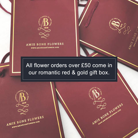 all flower orders over £50 come in our romantic red and gold gift box